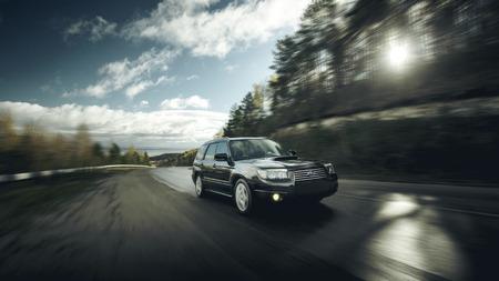 subaru: Khvalynsk, Russia - November 04, 2015: Black car Subaru Forester fast drive on asphalt road at daytime