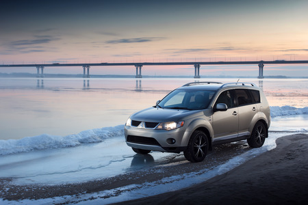 outlander: Saratov, Russia - November 27, 2014: Car Mitsubishi Outlander stay on ice coast at winter sunset Editorial