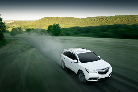 acura: Saratov, Russia - August 11, 2015: Modern car Acura MDX fast drive on dirt road at sunset