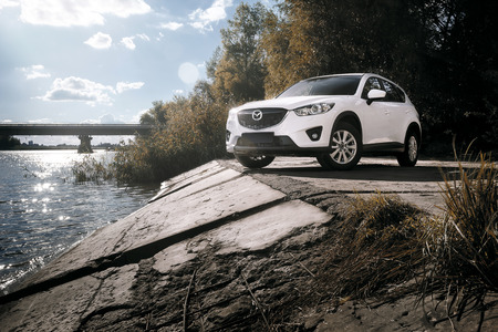 mazda: Saratov, Russia - August 30, 2014: Car Mazda CX-5 stand on asphalt countryside road near river at daytime