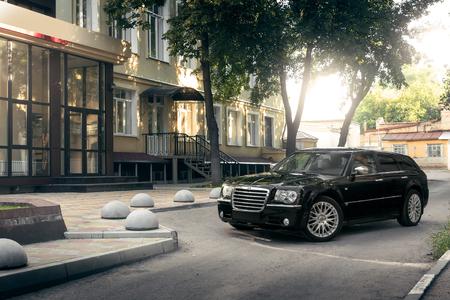 chrysler: Saratov, Russia - August 9, 2015: Black car Chrysler 300c standing on asphalt road in the city at daytime