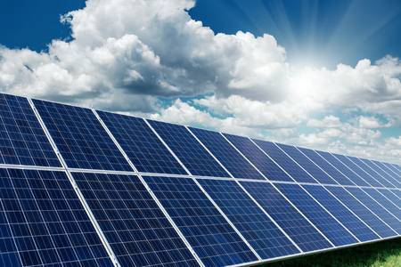 generate: Solar panels generate power energy on blue sky at daytime Stock Photo