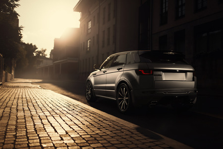 Moscow, Russia - August 06, 2016: Car Land Rover Range Rover Evoque standing on asphalt road in city Moscow at sunset Editorial