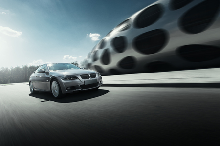 bmw: Minsk, Belarus - August 21, 2016: Car BMW Coupe E92 drive on asphalt road near modern building at daytime