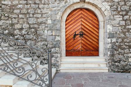 shearim: Old vintage wooden door in Budva citadel at old town