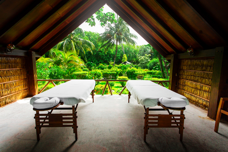 Spa beds ready to massage at outdoors tropical island resort Stock Photo