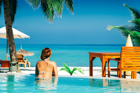 Woman in swimming pool at tropical island