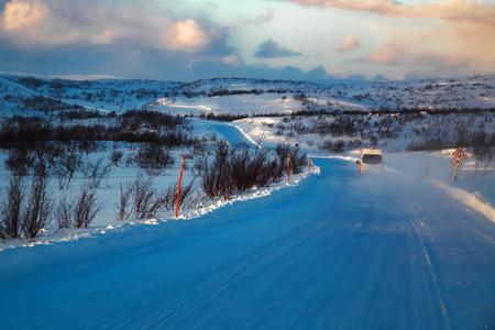 winter sunrise: Road at winter tundra. Kola Peninsula, Russia