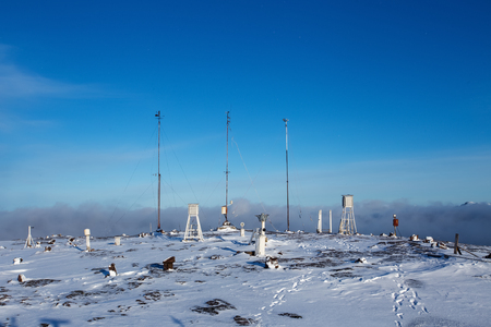 Meteorological station on mountain at winter daytime