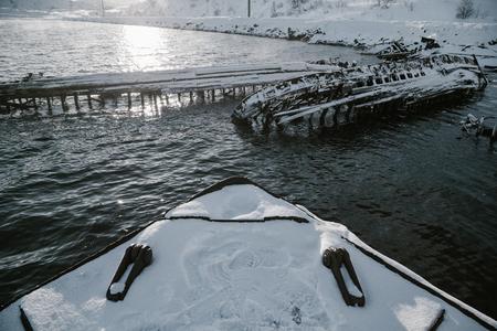 Parts of abandoned ships at northern coast at winter Stock Photo
