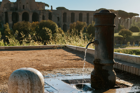 spqr: Old drinking water fountain in Rome, Italy