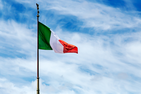 touristic: National flag of Italy on blue sky