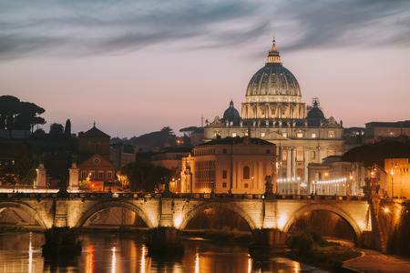tiber: View to bridge and Vatican City at sunset. Rome, Italy