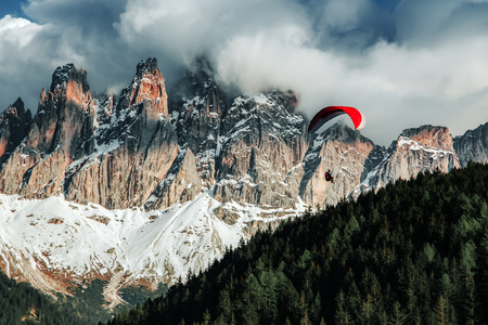 Paraglider flying near high mountains. Dolomites, Italy Stock Photo - 82596731