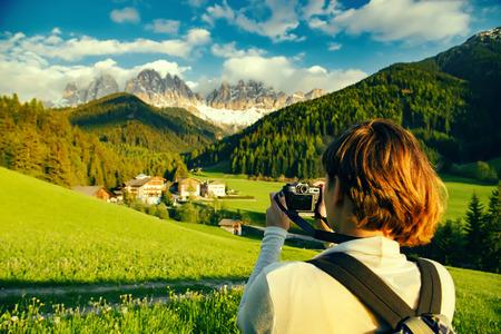 Woman with digital camera taking landscape photo Stock Photo