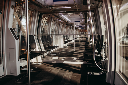 Unmanned drone empty train without driver. Inside view