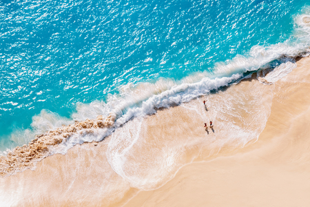 Aerial view to tropical sandy beach and blue ocean
