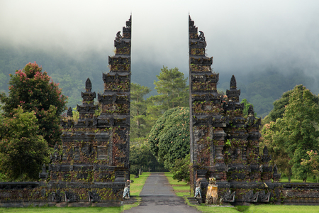 Traditional big gate entrance to temple. Bali Hindu temple. Bali island, Indonesia