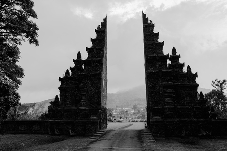 Traditional big gate entrance to temple. Bali Hindu temple. Bali island, Indonesia. Black and white toned