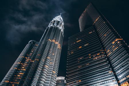 Petronas Twin Towers illuminated at night. Kuala Lumpur City Centre Park Stock Photo