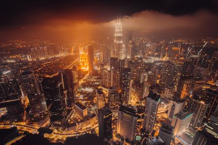 Aerial skyline view to Kuala Lumpur city, Malaysia. Business skyscrapers night downtown background Stock Photo