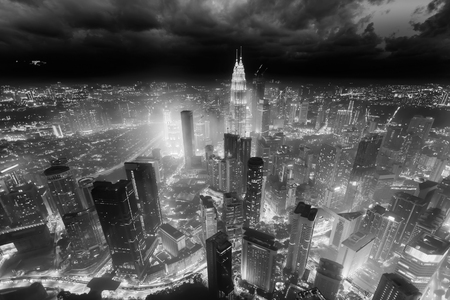 Aerial skyline view to Kuala Lumpur city, Malaysia. Cityscape business skyscrapers night downtown. Black and white toned