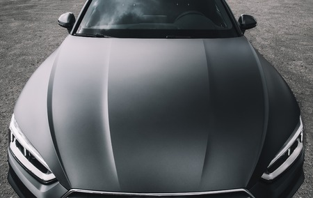 Modern car wrapped in grey color matte vinyl 免版税图像