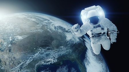Astronaut in open space. Earth planet background.