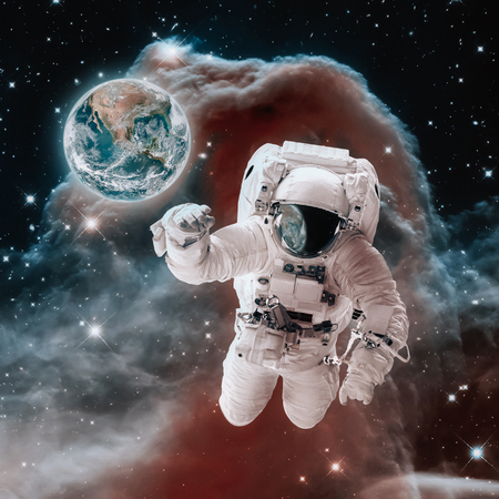 Astronaut in open space. Earth planet concept. Nebula background.