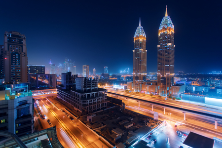 Beautiful view to Dubai and Sheikh Zayed Rd, United Arab Emirates. City skyline. Long exposure time lapse effect at night 写真素材
