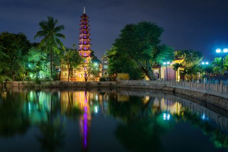 Hanoi city in Vietnam at night. Beautiful view to Tran Quoc Pagoda - famous landmark