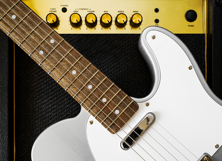 Guitar electric and amplifier. Rock music background. Top view