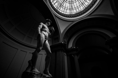 Marble statue David by Michelangelo in Accademia Gallery in Florence, Italy. Black and white toned