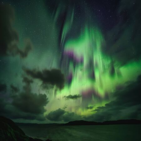 Northern Lights, Aurora Borealis in Kola Peninsula at night sky illuminated green. Murmansk region, Russia Archivio Fotografico - 132246941