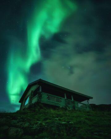 Northern Lights, Aurora Borealis in Kola Peninsula at night sky illuminated green. Murmansk region, Russia Archivio Fotografico - 132246917