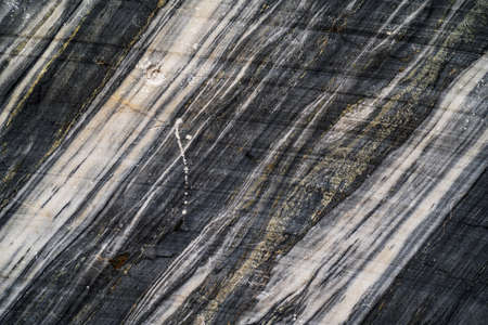 Dark marble stone raw texture. Abstract background
