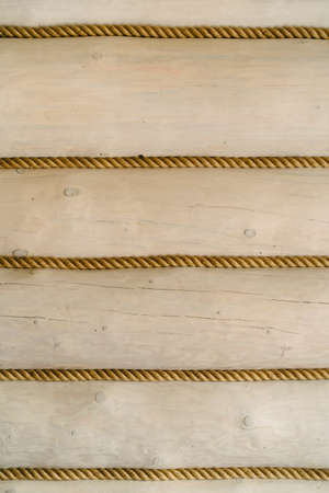Wooden texture background with ropes between logs