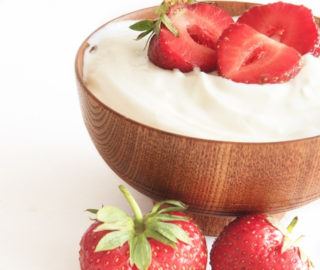strawberry and yogurt  in a wooden bowl Stock Photo - 9828506