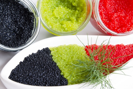 caviar in a jar and in a bowl-shaped over photo