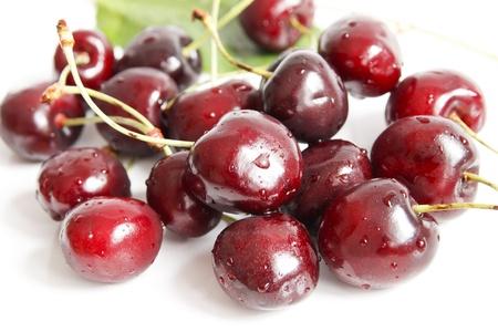 Wet cherries on white background