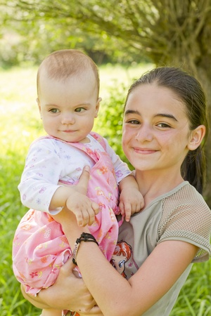 A teenage girl with a baby in arms Stock Photo - 10561332