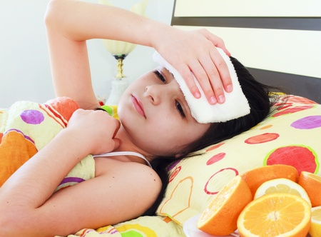 caucasian fever: Sick young girl in bed