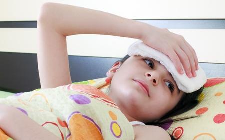 caucasian fever: Sick girl in bed