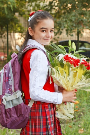 A pretty young girl on her way to school