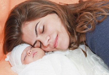 Baby sleeping AND HER MOTHER photo