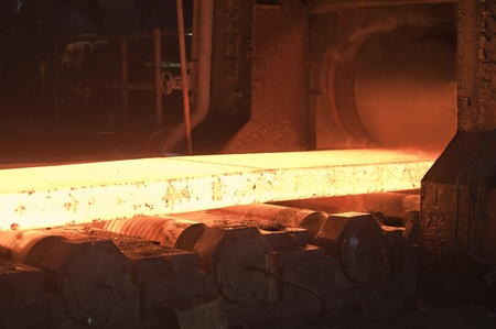 molted: hot steel on conveyor inside of plant