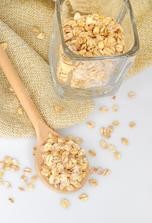 oat-flakes with a wooden spoon  photo