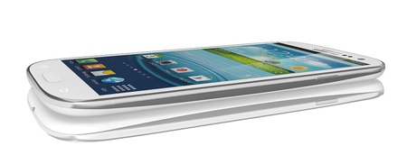 Samsung Galaxy S III Launches In 28 Countries in 2012. Latest phone runs off the latest Android OS, Ice Cream Sandwich (4.0.4), and is powered by a 1.4 GHz quad-core processor, a 2100 mAh battery and  has a 4.8-inch AMOLED display with a HD resolution of  Stock Photo - 14223582