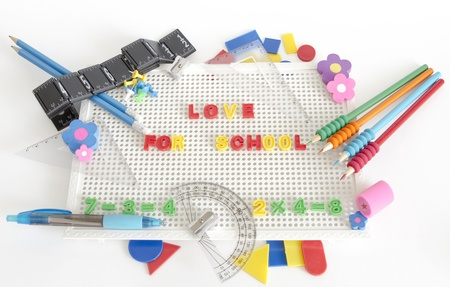 square ruler: text Love for School on white board with different accessories for school