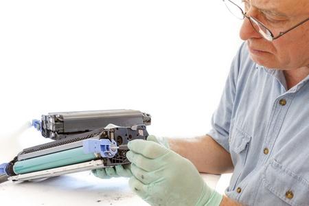 worker Laser printer on a workbench. Printer workshop